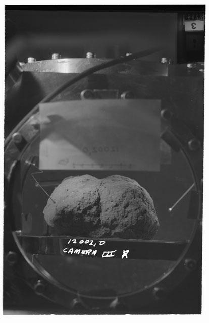 Black and white stereo photograph of Apollo 12 Sample 12002,0 using Camera III angle R.