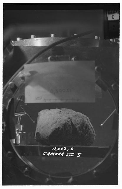Black and white stereo photograph of Apollo 12 Sample 12002,0 using Camera III angle S.