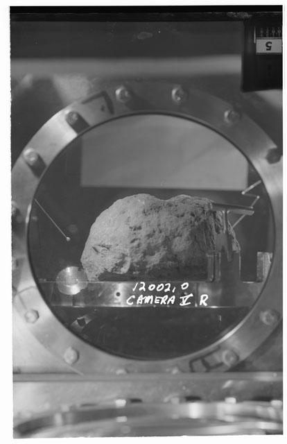 Black and white stereo photograph of Apollo 12 Sample 12002,0 using Camera V angle R.