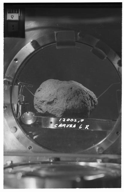 Black and white stereo photograph of Apollo 12 Sample 12002,0 using Camera VI angle R.