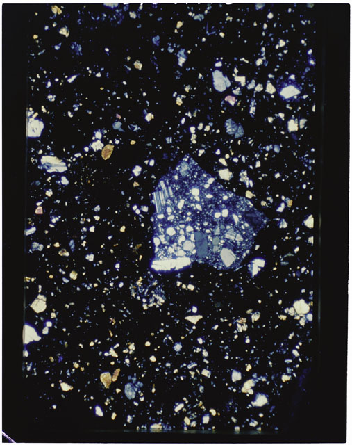 Color photograph of Apollo 11 Sample(s) 10021; Thin Section B using cross nichols light.