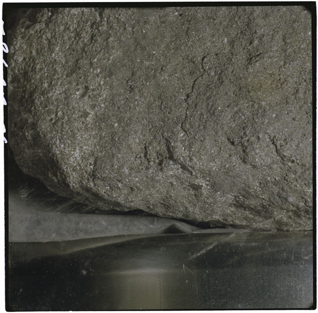 Black and white photograph of Apollo 12 sample 12051; Processing photograph displaying a close up of the surface.