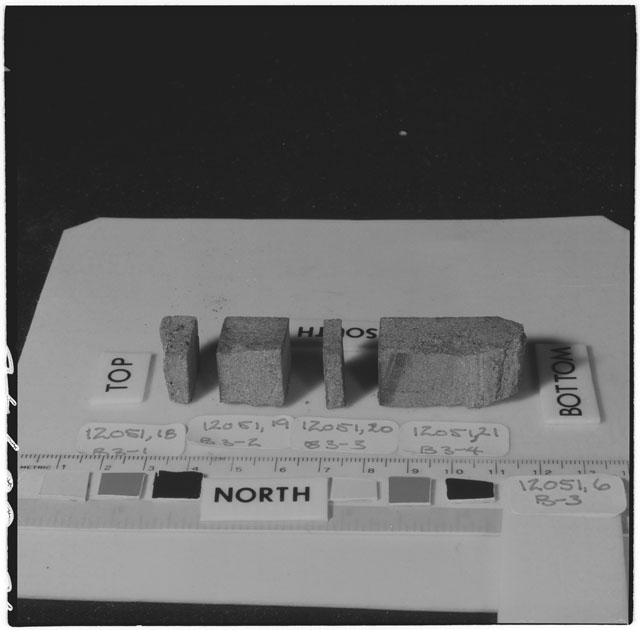 Black and white photograph of Apollo 12 Sample(S) 12051,6,18-21; Processing photograph displaying a post cut sample with an orientation of .