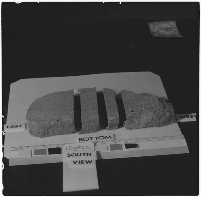 Black and white photograph of Apollo 12 Sample(S) 12051,2; Processing photograph displaying a post cut sample with an orientation of .