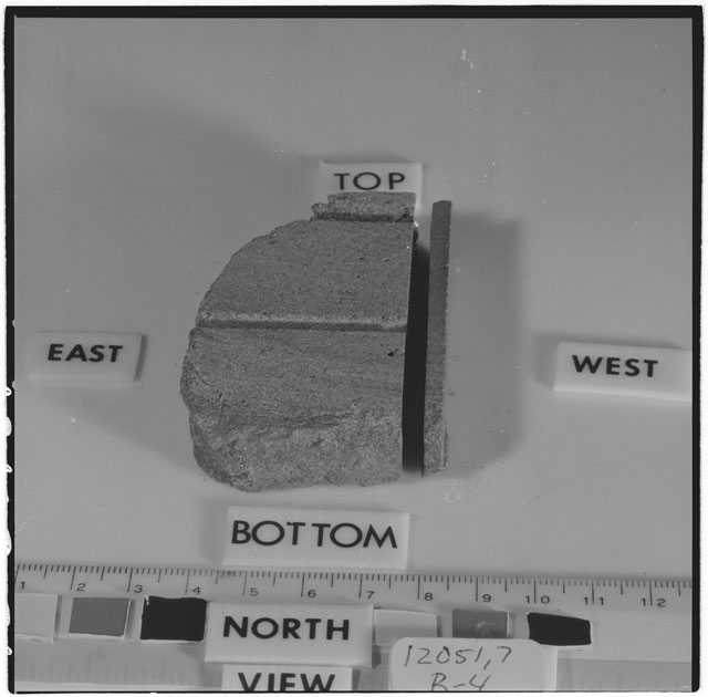 Black and white photograph of Apollo 12 Sample(S) 12051,7,27-30; Processing photograph displaying a reconstruction sample with an orientation of .
