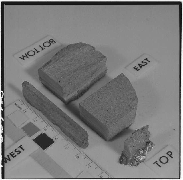 Black and white photograph of Apollo 12 Sample(S) 12051,7,27-30; Processing photograph displaying a post cut sample with an orientation of .