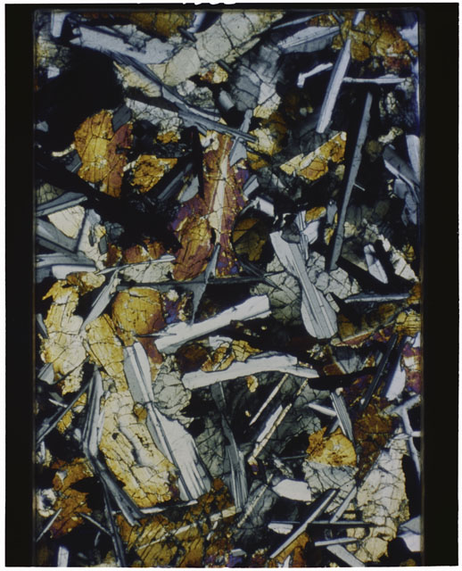 Color Thin Section photograph of Apollo 12 Sample(s) 12051,56 using cross nichols light.