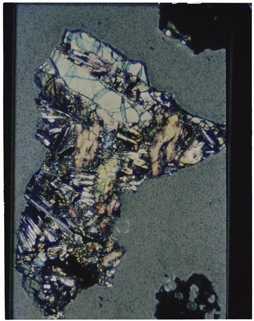 Color photograph of Apollo 12 sample 12070,160; Thin Section photograph displaying grain mount using cross nichols light.