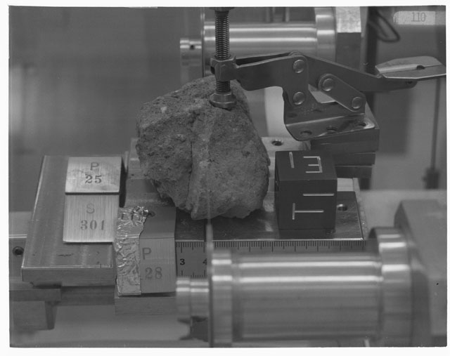 Black and white photograph of Apollo 14 Sample(s) 14301,0,25,28; Processing photograph displaying cutting with an orientation of T,E .