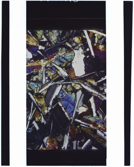 Color Thin Section photograph of Apollo 12 Sample(s) 12051 using cross nichols light.