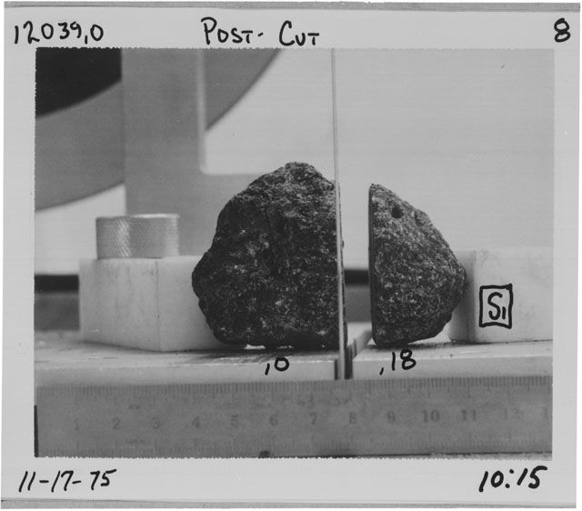Black and white photograph of Apollo 12 Sample(S) 12039,0,18; Processing photograph displaying a post cut sample with an orientation of S.