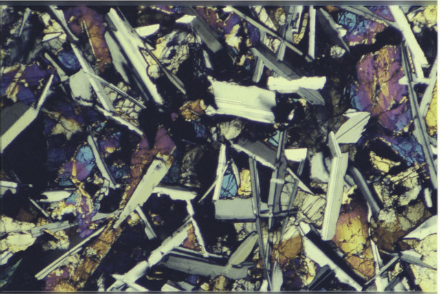 Color 2.7 MM Thin Section photograph of Apollo 12 Sample(s) 12051,54 using cross nichols light.