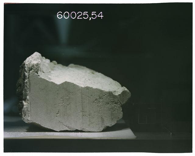 Color photograph of Apollo 16 Sample(s) 60025, 54; Ortho photo with orientation E.