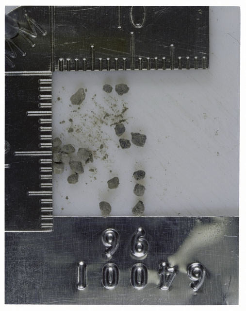 Color photograph of Apollo 16 Core Sample 64001,96; Processing photograph displaying >1 MM Core Fines .
