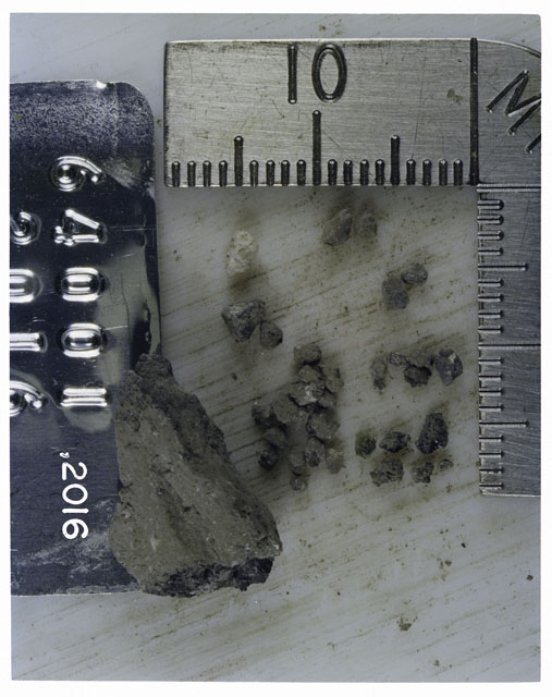 Color photograph of Apollo 16 Core Sample 64001,2016; Processing photograph displaying >1 MM Core Fines .