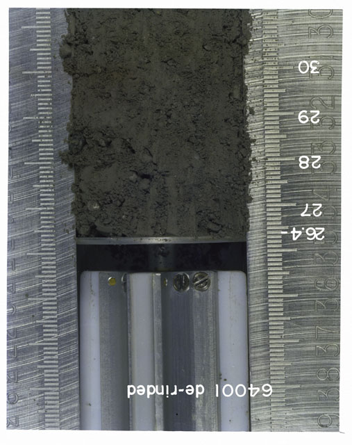Color photograph of Apollo 16 Core Sample 64001; Processing photograph displaying 26.4-30 cm depth Core Tube derinded.