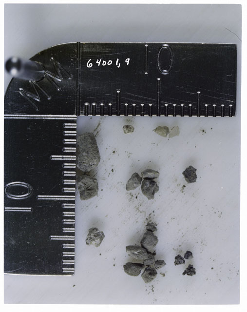 Color photograph of Apollo 16 Core Sample 64001,9; Processing photograph displaying >1 MM Core Fines .