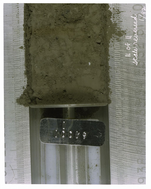 Color photograph of Apollo 16 Core Sample(s) 64001,1; 11 of 11 Processing photograph of displaying Core with scale reversed.