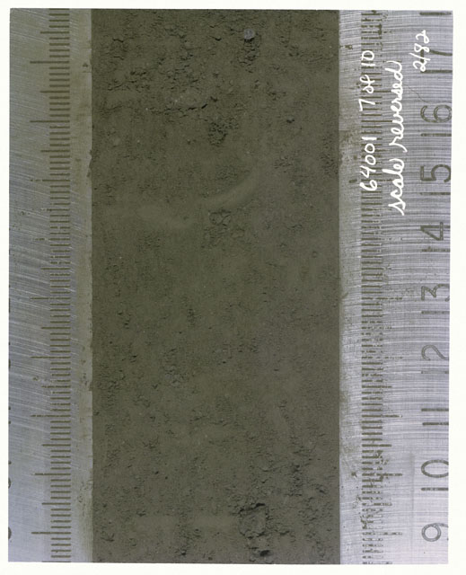 Color photograph of Apollo 16 Core Sample(s) 64001,1; 7 of 10 Processing photograph of displaying Core with scale reversed.