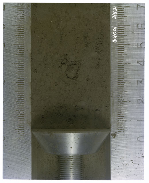 Color photograph of Apollo 16 Core Sample(s) 64001,1; Processing photograph of displaying Core with .