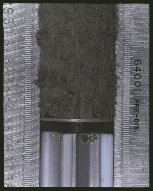 Color photograph of Apollo 16 Sample(s) 64001; 1 of 11 Processing photograph displaying pre-dissection Core at 29-35 cm depth.