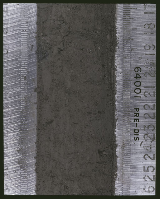 Color photograph of Apollo 16 Sample(s) 64001; 5 of 11 Processing photograph displaying pre-dissection Core at 17-26 cm depth.