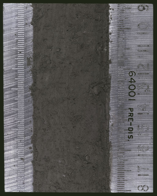 Color photograph of Apollo 16 Sample(s) 64001; 7 of 11 Processing photograph displaying pre-dissection Core at 9-18 cm depth.