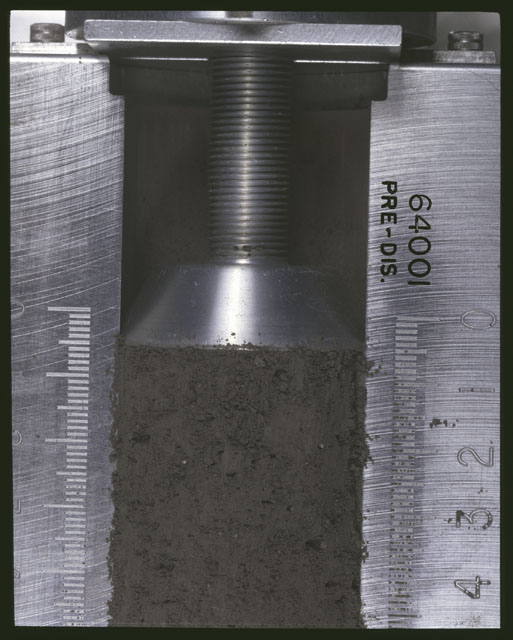 Color photograph of Apollo 16 Sample(s) 64001;Processing photograph displaying pre-dissection Core at 0-4.5 cm depth.