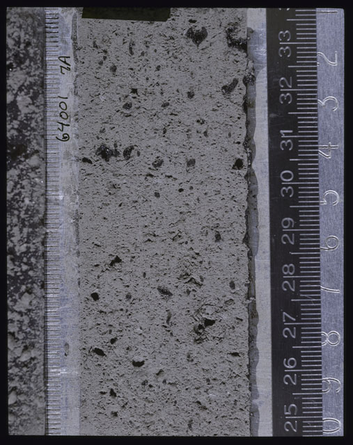 Color photograph of Apollo 16 Core Sample(s) 64001; Processing photograph displaying Core after peel with clod 7A.