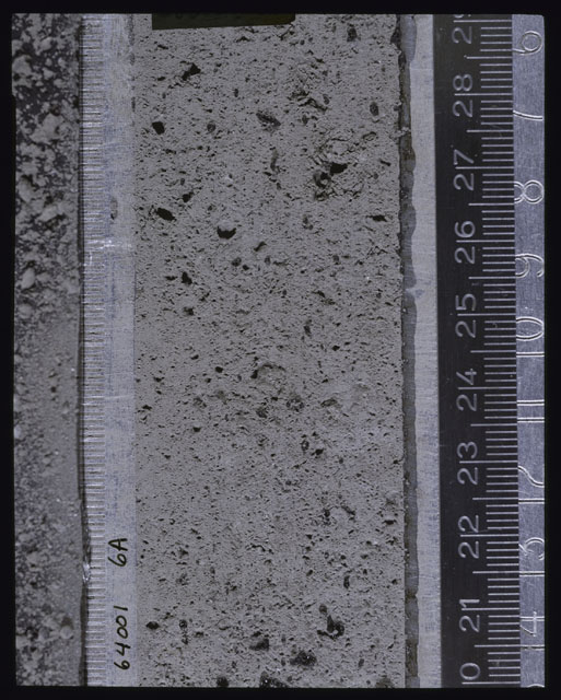 Color photograph of Apollo 16 Core Sample(s) 64001; Processing photograph displaying Core after peel with clod 6A.