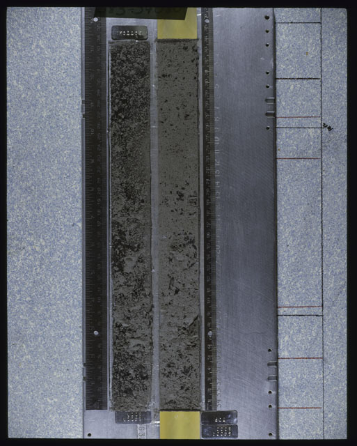 Color photograph of Apollo 16 Core Sample(s) 64001; Processing photograph displaying an overview of a Core with peel.