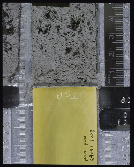 Color photograph of Apollo 16 Sample(s) 64001; 1 of 8 Processing photograph displaying post peel Core at 0-5 cm depth.