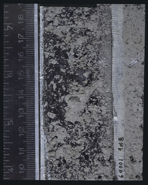 Color photograph of Apollo 16 Sample(s) 64001,6001; 4 of 8 Processing photograph displaying peel side Core at 9.5-18.5 cm depth.