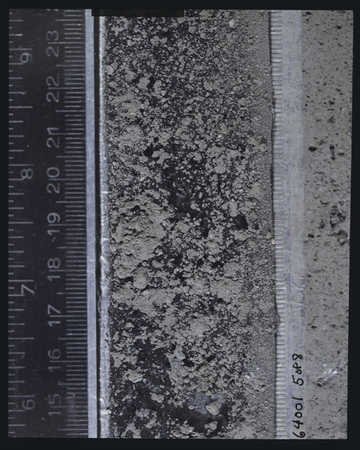 Color photograph of Apollo 16 Sample(s) 64001,6001; 5 of 8 Processing photograph displaying peel side Core at 14.5-23.5 cm depth.