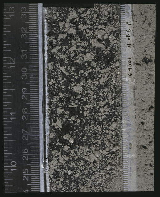 Color photograph of Apollo 16 Sample(s) 64001; 4 of 6 A Processing photograph displaying peel Core at 24.5-33.5 cm depth.