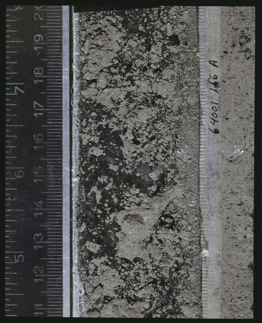 Color photograph of Apollo 16 Sample(s) 64001; 1 of 6 A Processing photograph displaying peel Core at 11-20 cm depth.