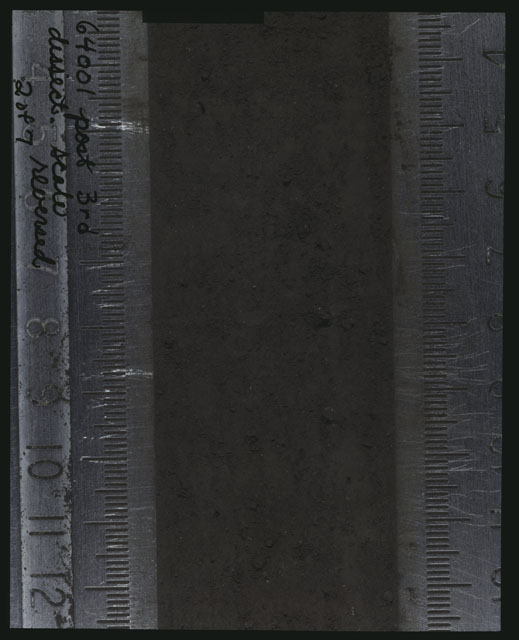 Color photograph of Apollo 16 Core Sample(s) 64001; 2 of 7 Processing photograph displaying post 3rd dissection Core with the scale reversed.