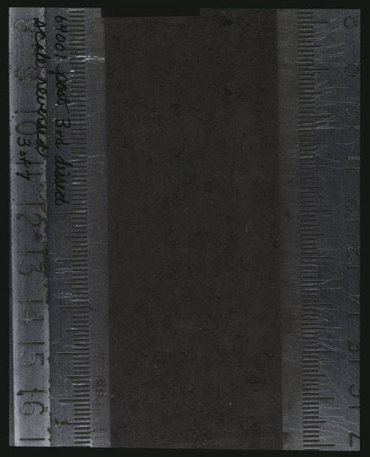 Color photograph of Apollo 16 Core Sample(s) 64001; 3 of 7 Processing photograph displaying post 3rd dissection Core with the scale reversed.