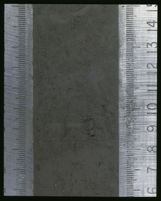 Color photograph of Apollo 16 Sample(s) 64001,1; Processing photograph displaying Core at 6-15 cm depth.
