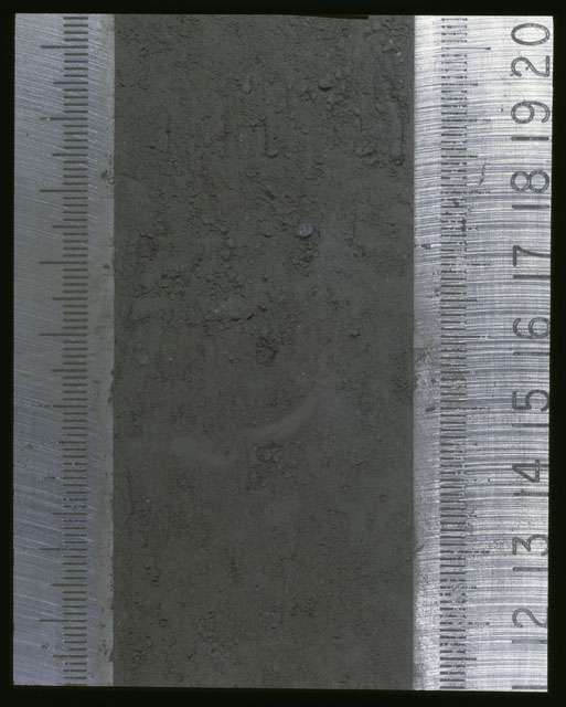 Color photograph of Apollo 16 Sample(s) 64001,1; Processing photograph displaying Core at 11.5-20.5 cm depth.