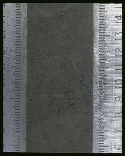 Color photograph of Apollo 16 Sample(s) 64001,1; Processing photograph displaying Core at 6-14.5 cm depth.