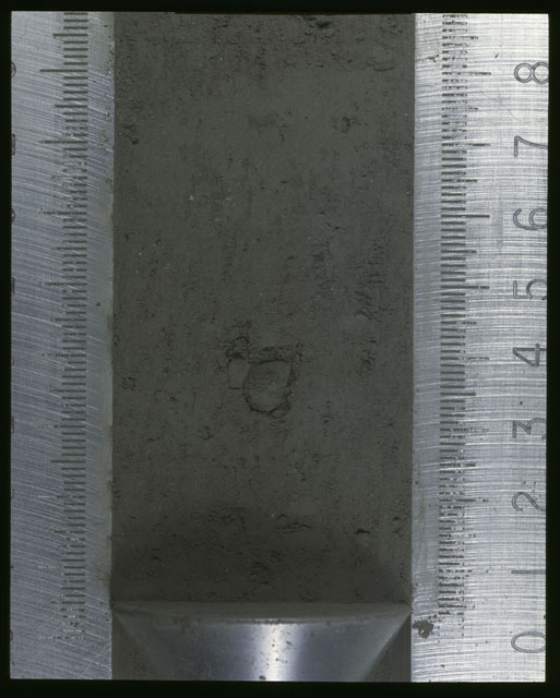 Color photograph of Apollo 16 Sample(s) 64001,1; Processing photograph displaying Core at 0-8.5 cm depth.